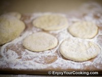From each piece of dough form round dough circle (use rolling pin if needed)
