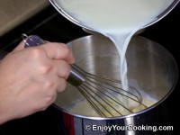 Stir boiled milk in